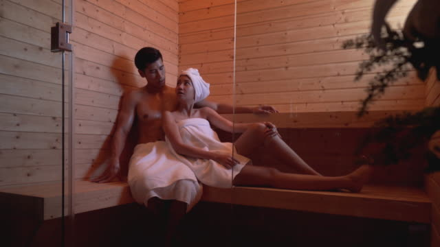 young couple relaxing in a sauna room. - sauna stock videos and b-roll footage