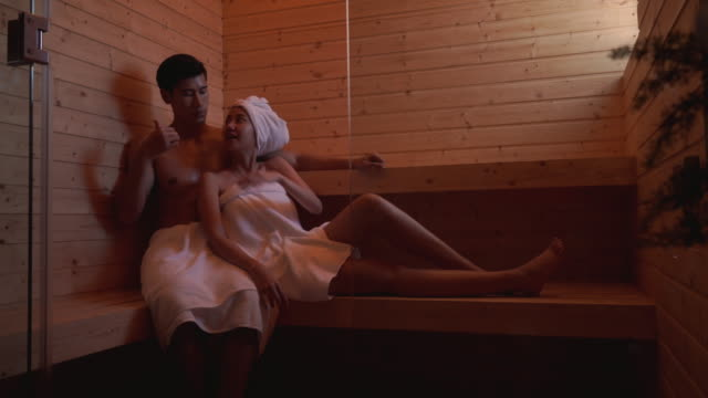 young couple relaxing in a sauna - sauna stock videos & royalty-free footage