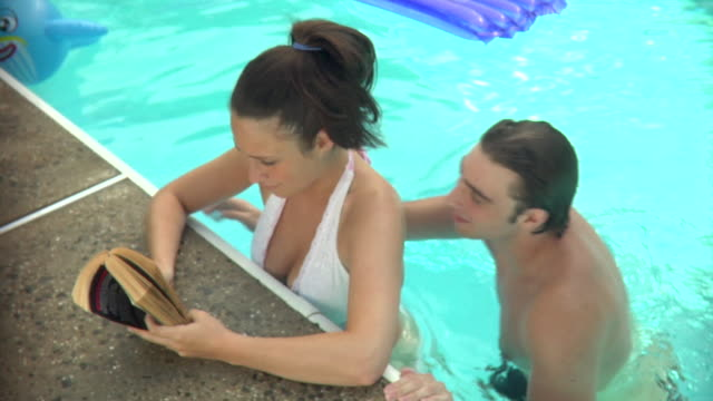 cu, ha, young couple relaxing in swimming pool, middlesex, new jersey, usa - chest kissing stock videos & royalty-free footage