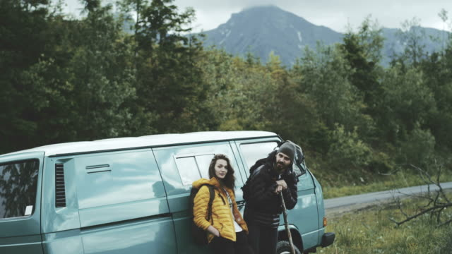 Young couple relaxing in the mountains