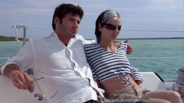 ms, td, young couple relaxing on boat, harbour island, bahamas  - stoppelbart stock-videos und b-roll-filmmaterial