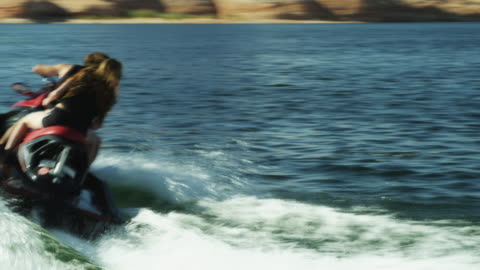 ws ts young couple riding jet boat in lake powell / utah, usa - lake powell stock videos & royalty-free footage