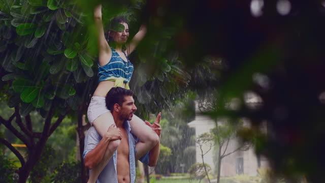 young couple romancing in rain season, delhi, india - shoulder ride woman stock videos & royalty-free footage