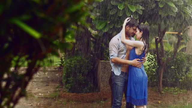 Young couple romancing in rain season, Delhi, India