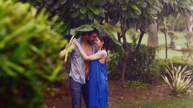 young couple romancing in rain season, delhi, india - machine part stock videos & royalty-free footage