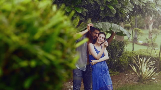 young couple romancing in rain season, delhi, india - unterhalb stock-videos und b-roll-filmmaterial