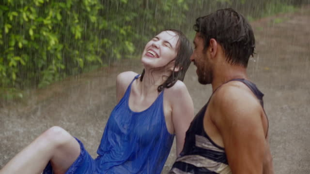 Young couple romancing in the rain, Delhi, India
