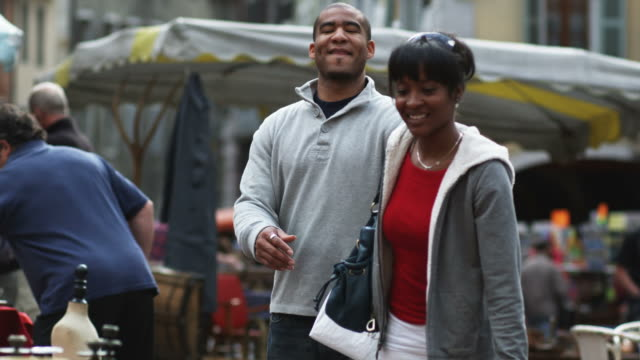 young couple shopping in a European outdoor market