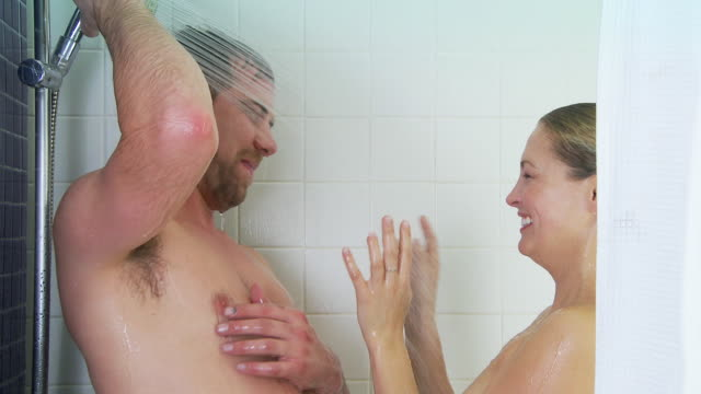 Young couple showering together