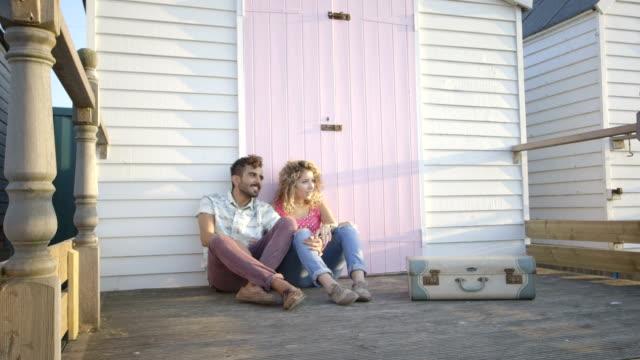young couple sitting hut - railings stock videos & royalty-free footage