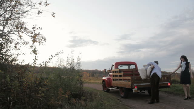 ws young couple sitting in old truck  / stillwater, minnesota, usa - privatfahrzeug stock-videos und b-roll-filmmaterial