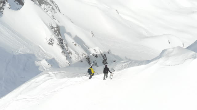 young couple skiing mountain climbing extreme off piste - guide stock videos & royalty-free footage