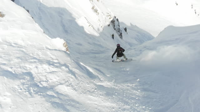 young couple skiing mountain climbing extreme off piste - snowboarding stock videos and b-roll footage