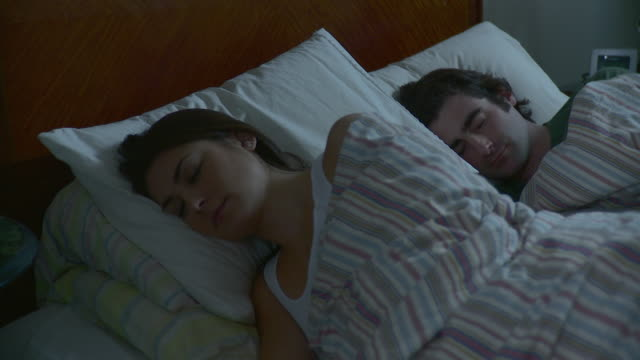 ms pan young couple sleeping in bed / brooklyn, new york city, new york, usa - kopfkissen stock-videos und b-roll-filmmaterial