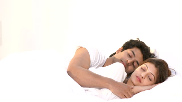 ms young couple sleeping together on bed at home / delhi, india - auf der seite liegen stock-videos und b-roll-filmmaterial