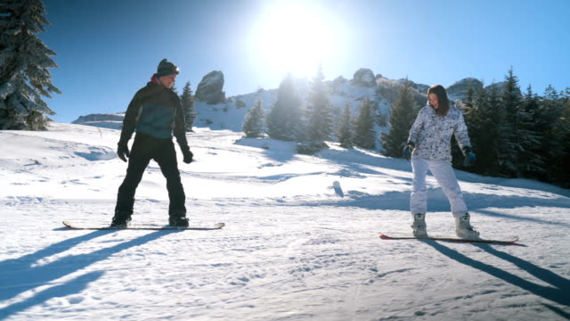 young couple snowboarding - ski slope stock videos & royalty-free footage