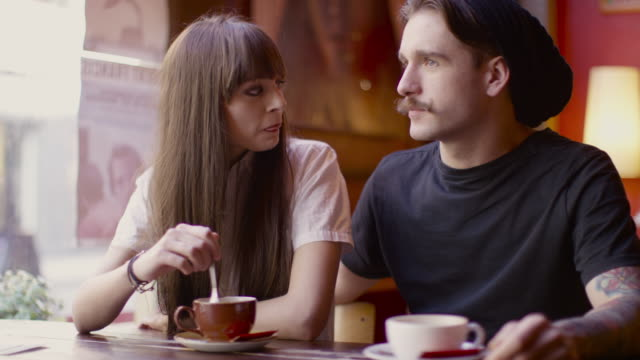 A young couple spending time togetherr in a coffee shop in Manchester