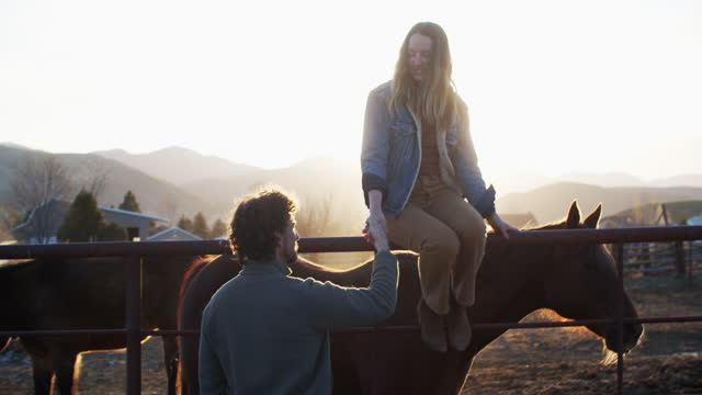 young couple standing by their horses talking - dating stock videos & royalty-free footage