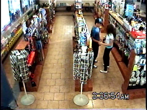 ha ws young couple stealing merchandise from convenience store and then shrugging to unseen cashier / brooklyn, new york, usa - blame stock videos & royalty-free footage