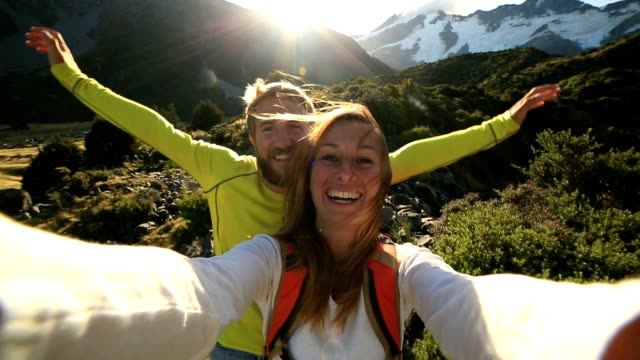 young couple take self portrait on mountain background - bonding stock videos & royalty-free footage