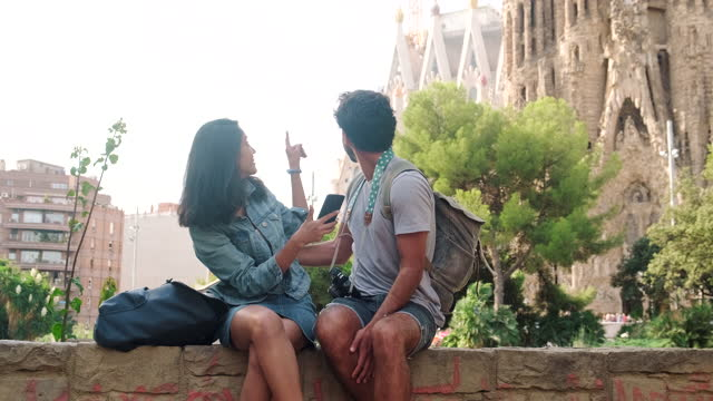 young couple taking break from sightseeing - city break stock videos & royalty-free footage