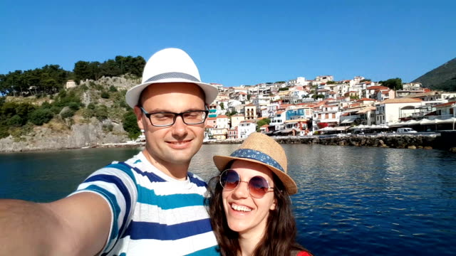 young couple taking holiday selfie - waving gesture stock videos & royalty-free footage