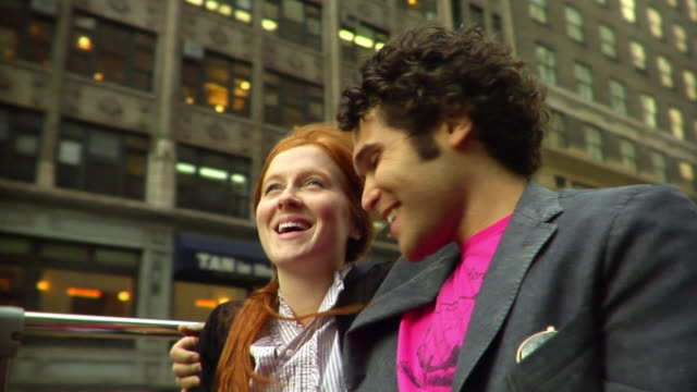 cu young couple taking photo of themselves with digital camera as they ride on the top level of a tour bus/ new york city - sideburn stock videos and b-roll footage