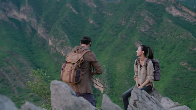 young couple taking photos with camera outdoors,4k - rock stock videos & royalty-free footage