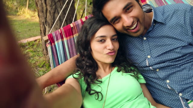 young couple taking selfie with a video camera, solan, himachal pradesh - young couple stock videos & royalty-free footage