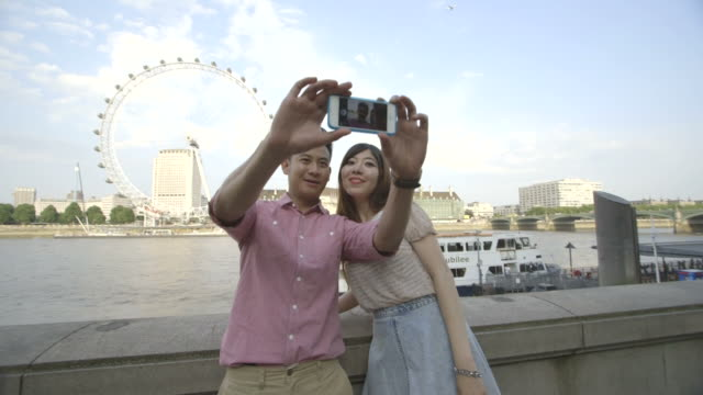 young couple taking self-portrait - passenger craft stock videos & royalty-free footage