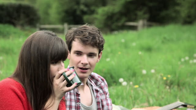 young couple talking in field - guildford stock videos & royalty-free footage