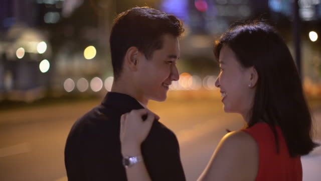 cu young couple talking together at night - flirting stock videos & royalty-free footage