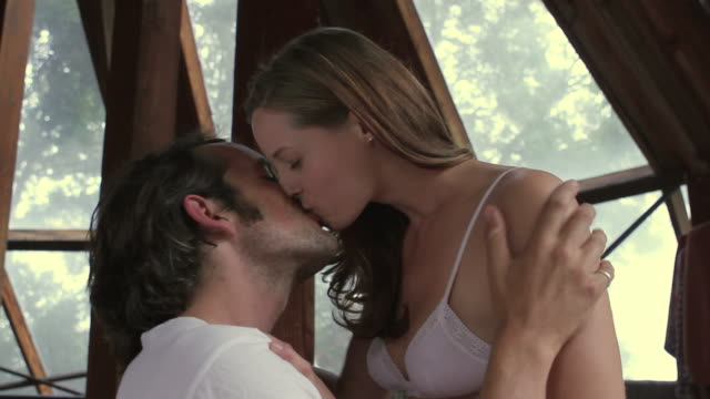 cu young couple together in bed kissing and making love / big sur, california, usa - making stock videos and b-roll footage
