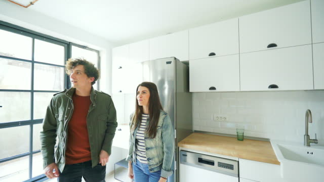 young couple visiting a new house. - kitchen stock videos & royalty-free footage