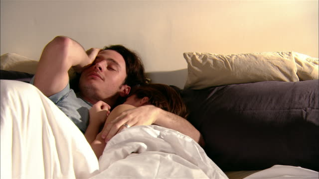 young couple waking up in morning / woman getting out of bed - getting out stock videos & royalty-free footage