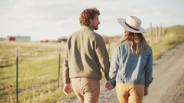 rv ts young couple walking on a country road together - girlfriend stock videos & royalty-free footage
