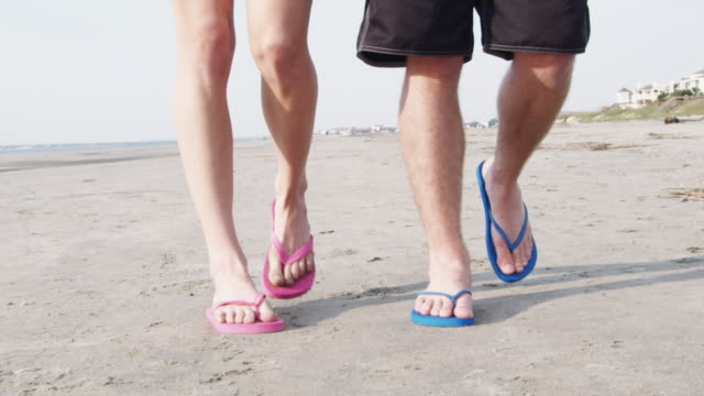 cu ts slo mo young couple walking on beach / isle of palms, south carolina, usa - carolina beach stock videos and b-roll footage