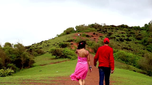 young couple walking on chapora fort, goa - goa stock videos & royalty-free footage