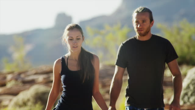 ms cu td young couple walking on rocks near lake powell, holding hands/ utah, usa - lake powell stock videos & royalty-free footage