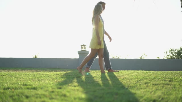 WS SM Young couple walking on the grass together
