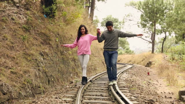 Young couple walking on the railway track, Solan, Himachal Pradesh