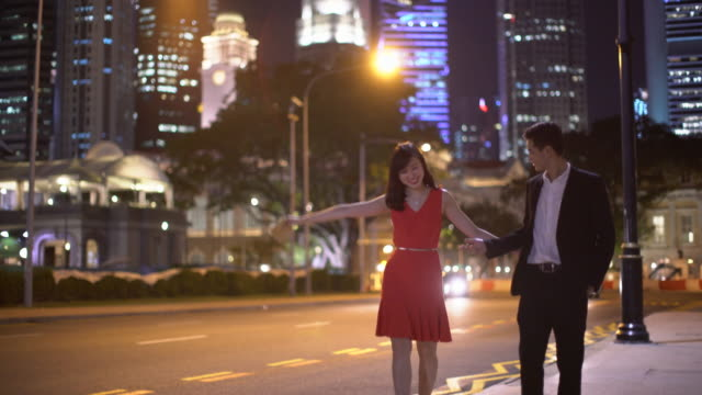 WS TS young couple walking together at night