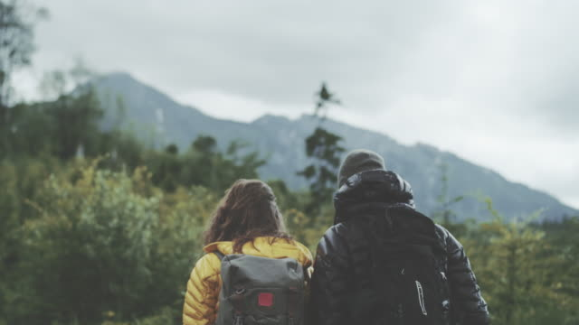 Young couple walking together in mountains