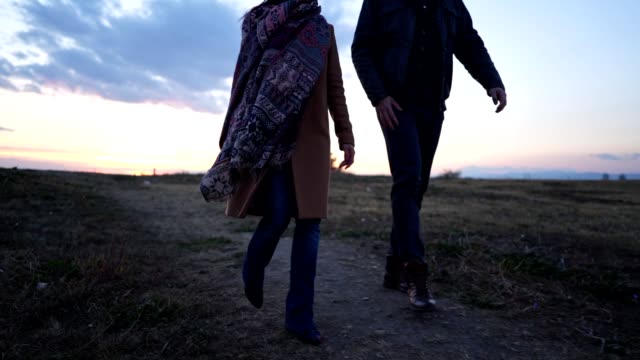 young couple walking with romantic sky - romantic sky stock videos & royalty-free footage