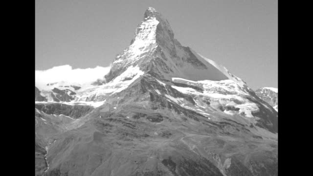 vs young couple walks at stone wall with scenic view of the matterhorn in the distance a waitress in a mountain cafe brings a tray to a small table... - stone wall stock videos & royalty-free footage