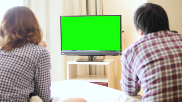 4K : Young Couple Watch Chromakey TV