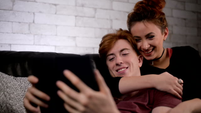 Young couple watching movie on tablet