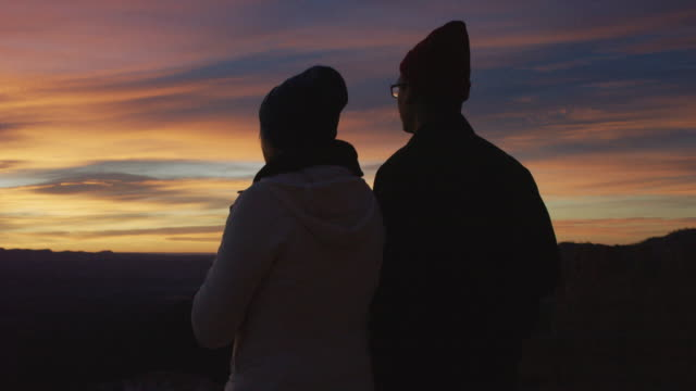 Young couple watching the sun rise