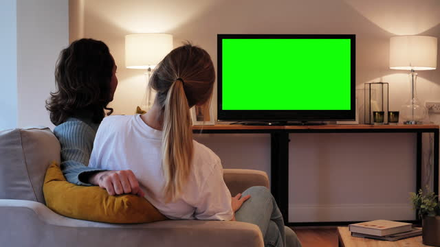 young couple watching tv chroma key - watching stock videos & royalty-free footage