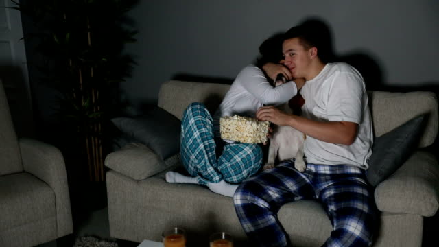 young couple watching tv together - date night romance stock videos and b-roll footage